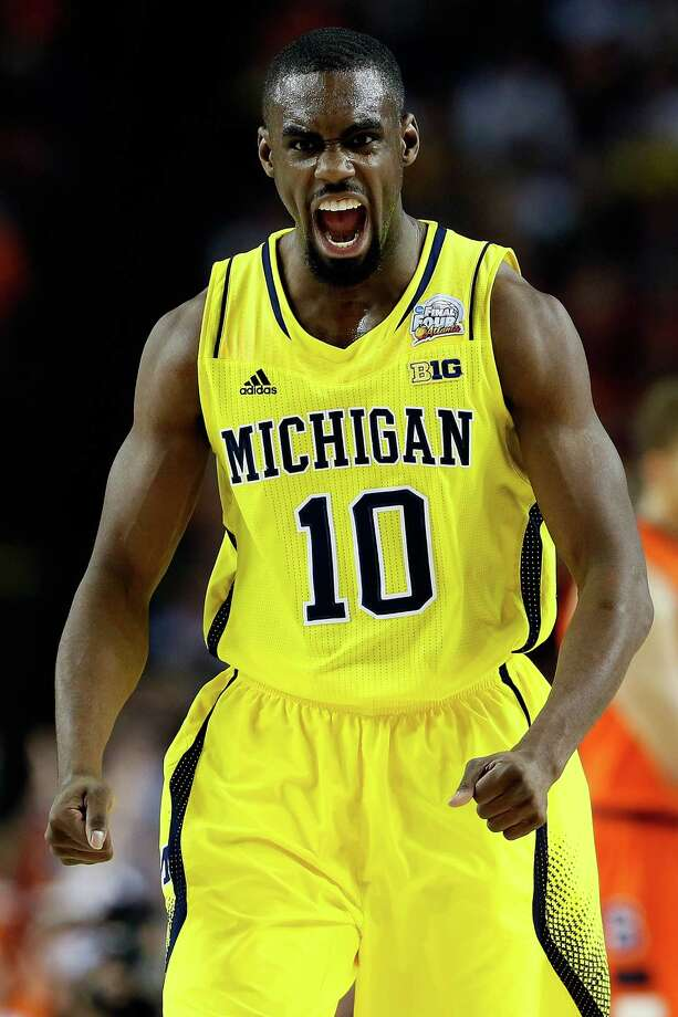 ATLANTA, GA - APRIL 06:  Tim Hardaway Jr. #10 of the Michigan Wolverines reacts in the first half against the Syracuse Orange during the 2013 NCAA Men's Final Four Semifinal at the Georgia Dome on April 6, 2013 in Atlanta, Georgia. Photo: Kevin C. Cox, Getty Images / 2013 Getty Images