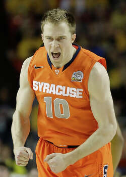 Syracuse's Trevor Cooney (10) reacts to play against Michigan during the first half of the NCAA Final Four tournament college basketball semifinal game Saturday, April 6, 2013, in Atlanta. (AP Photo/David J. Phillip) Photo: David J. Phillip, Associated Press / AP