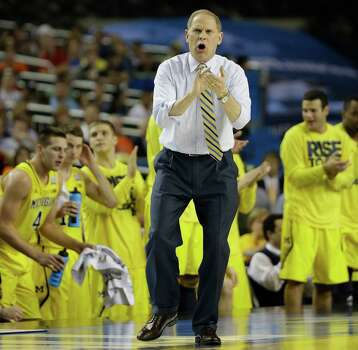 Michigan head coach John Beilein speaks to players against Syracuse during the first half of the NCAA Final Four tournament college basketball semifinal game Saturday, April 6, 2013, in Atlanta. (AP Photo/David J. Phillip) Photo: David J. Phillip, Associated Press / AP