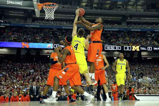 ATLANTA, GA - APRIL 06:  Rakeem Christmas #25 of the Syracuse Orange attempts a shot in the first half against Mitch McGary #4 of the Michigan Wolverines during the 2013 NCAA Men's Final Four Semifinal at the Georgia Dome on April 6, 2013 in Atlanta, Georgia. Photo: Streeter Lecka, Getty Images / 2013 Getty Images