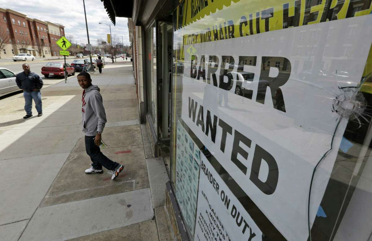 """A """"help wanted"""" sign in Richmond, Va., reflects the reality of the job market. Employers added just 88,000 jobs in March, the fewest in nine months."""