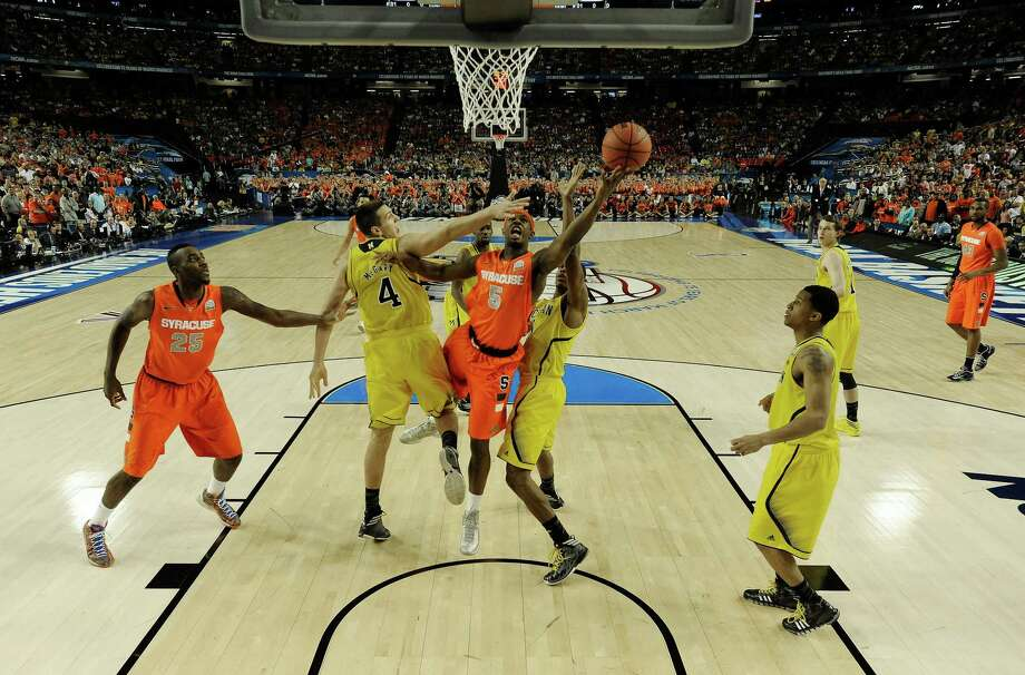 Syracuse's C.J. Fair shoots against Michigan's Mitch McGary (4) during the first half of the NCAA Final Four tournament college basketball semifinal game, Saturday, April 6, 2013, in Atlanta. (AP Photo/NCAA Photos, Chris Steppig, Pool) Photo: Chris Steppig, Associated Press / NCAA Photos
