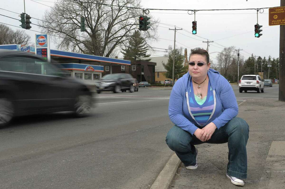 Colleen Ouellette poses along Central Ave. on Sunday, March 31, 2013 in Albany, NY. Ouellette was struck by a car while she was walking across Central Ave. in September of 2011. She was not seriously injured. (Paul Buckowski / Times Union)