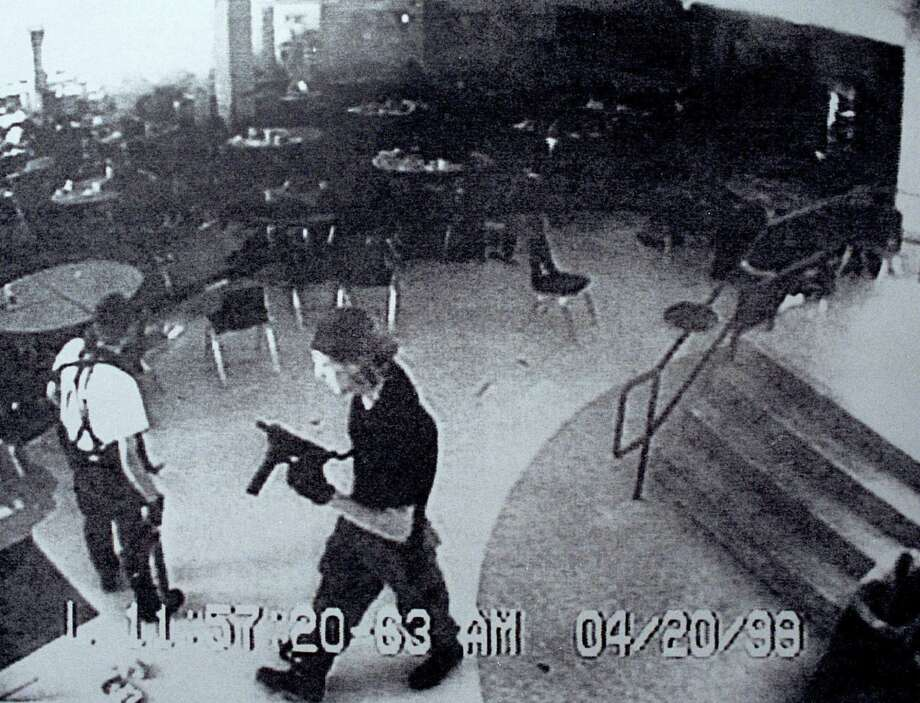Columbine shooters Eric Harris (left) and Dylan Klebold are shown during the attack in 1999, after which some police departments began telling officers to act immediately rather than wait for backup. Now, after similar attacks recently, police have begun advising the public to also not wait for help. Photo: Jefferson County (Colo.) Sheriff's Office / New York Times