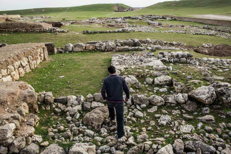 Rebel fighter Ali Shibleh walks amid the ruins of the ancient city of Ebla, a publicly celebrated archaeological site. Photo: Bryan Denton / New York Times