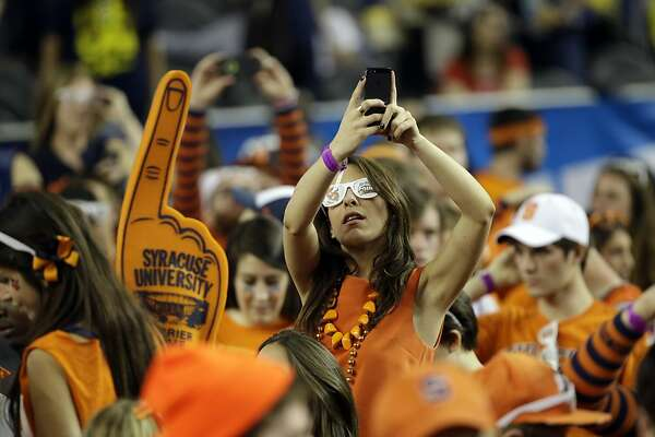 Syracuse fans cheer during the first half of the NCAA Final Four tournament college basketball semifinal game against Michigan  Saturday, April 6, 2013, in Atlanta. (AP Photo/David J. Phillip)