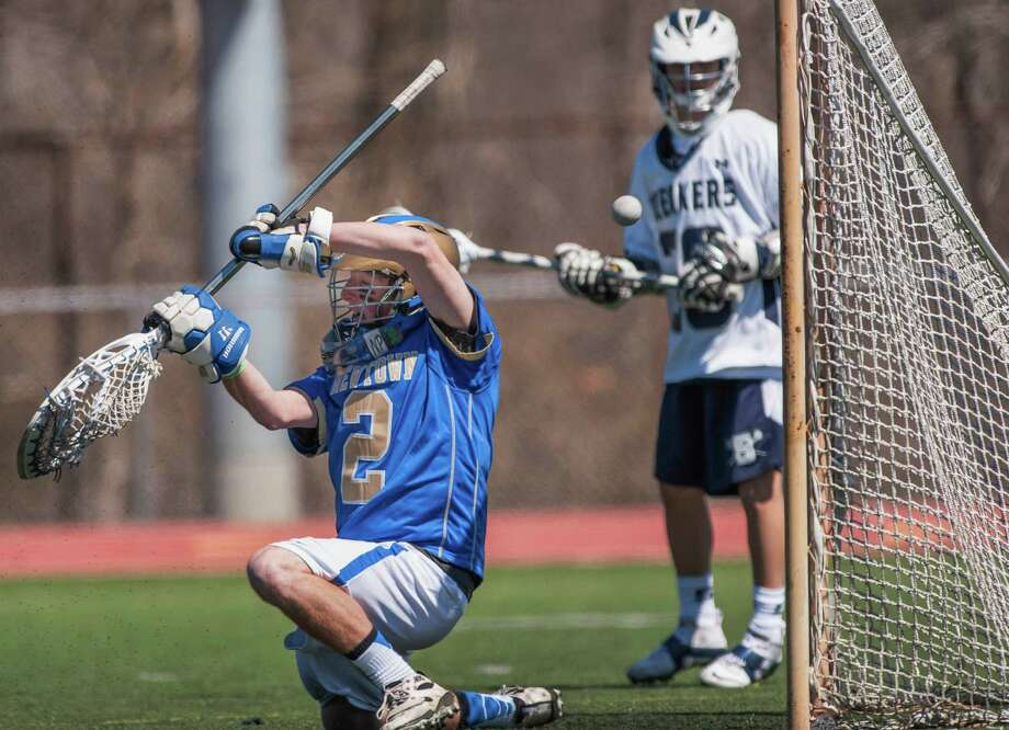 A shot goes wide of the goal and Newtown High School goalie Evan Issacs during a boys lacrosse game against Staples High School played at Staples High School, Westport, CT on Saturday April 6th, 2013. Photo: Mark Conrad / Connecticut Post Freelance