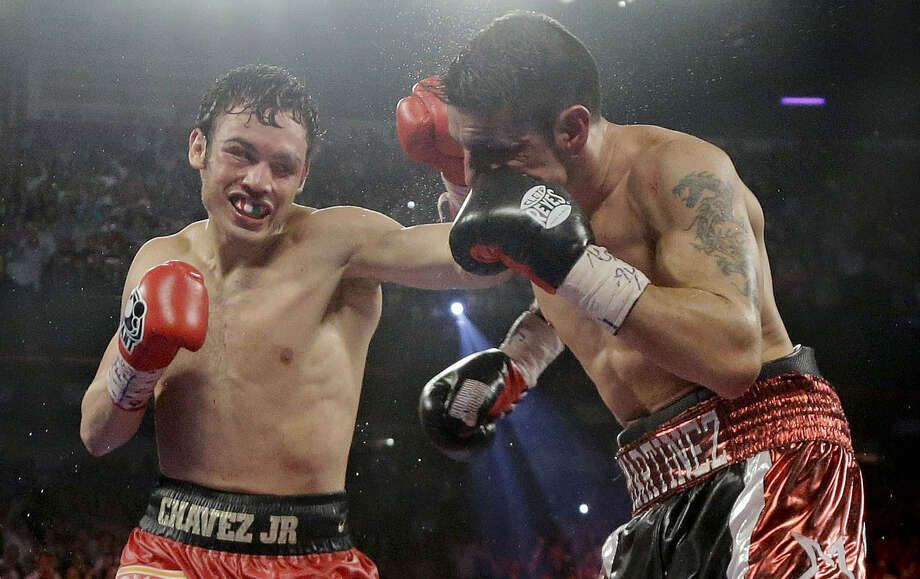Julio Cesar Chavez Jr. (left) has not fought since losing to Sergio Martinez (right) by decision in September. Chavez failed a drug test after the bout, which got him suspended in March. Photo: Julie Jacobson / Associated Press