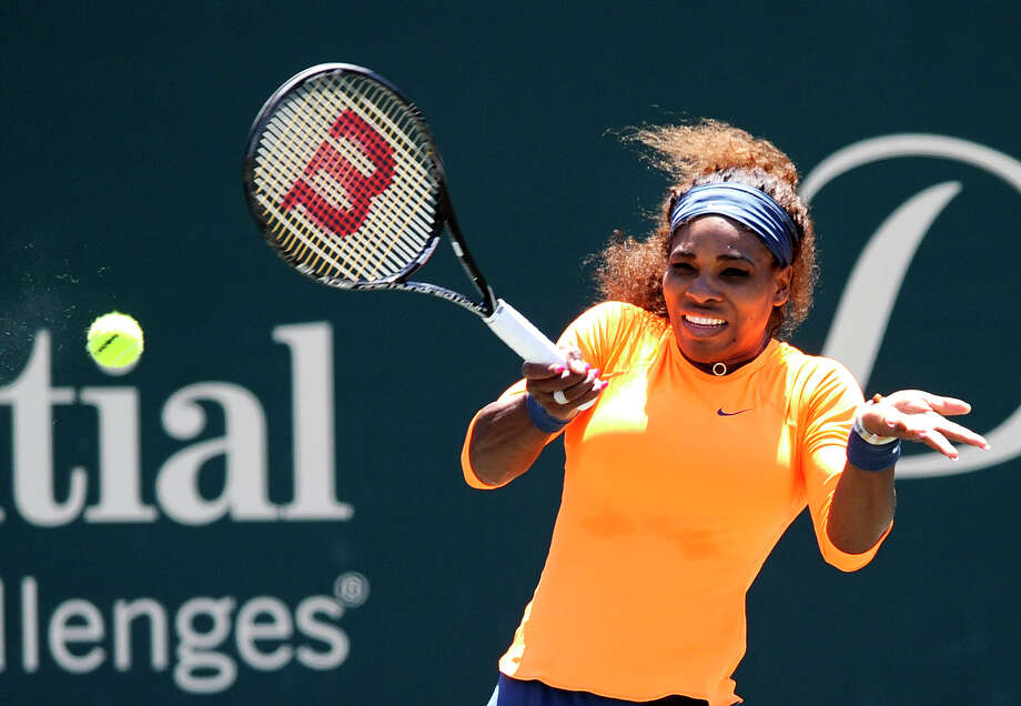 Serena Williams hits a forehand shot during a semifinal match against her sister Venus Williams at the Family Circle Cup tennis tournament in Charleston, S.C., Saturday, April 6, 2013. Serena won 6-1, 6-2. (AP Photo/Stephen Morton) Photo: Stephen Morton