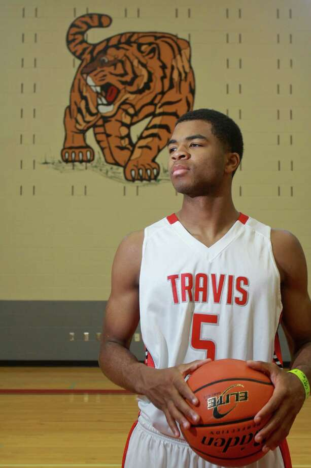 Andrew Harrison, along with twin brother Aaron, helped lead Travis to the Class 5A state championship. Both are headed to Kentucky in the fall. Photo: Gary Fountain, Freelance / Copyright 2013 Gary Fountain