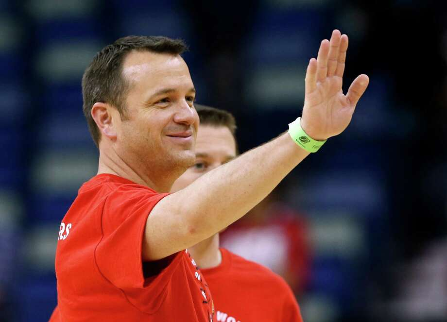 Louisville head coach Jeff Walz waves during practice at the Women's Final Four of the NCAA college basketball tournament, Saturday, April 6, 2013, in New Orleans. Louisville plays California in a semifinal game on Sunday. (AP Photo/Dave Martin) Photo: Dave Martin