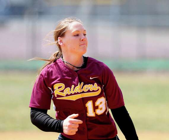 Colonie softball sensation Kelly Lane unleashes against pitch Averill Park Friday lunchtime, April 5, 2013. (Will Waldron /Times Union) Photo: Will Waldron