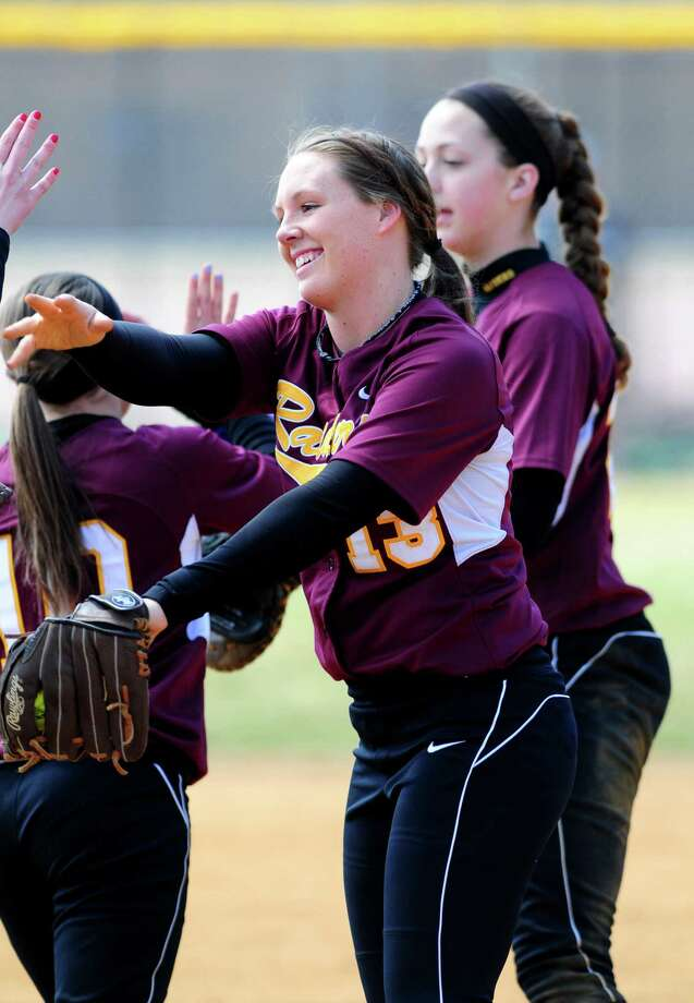 Colonie softball sensation Kelly Lane celebrates with teammates following an inning against Averill Park Friday lunchtime, April 5, 2013. (Will Waldron /Times Union) Photo: Will Waldron