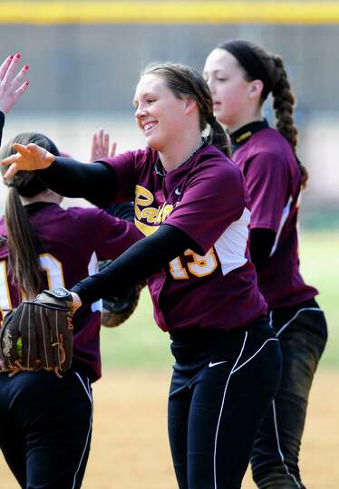 Colonie softball sensation Kelly Lane celebrates with teammates following an inning against Averill