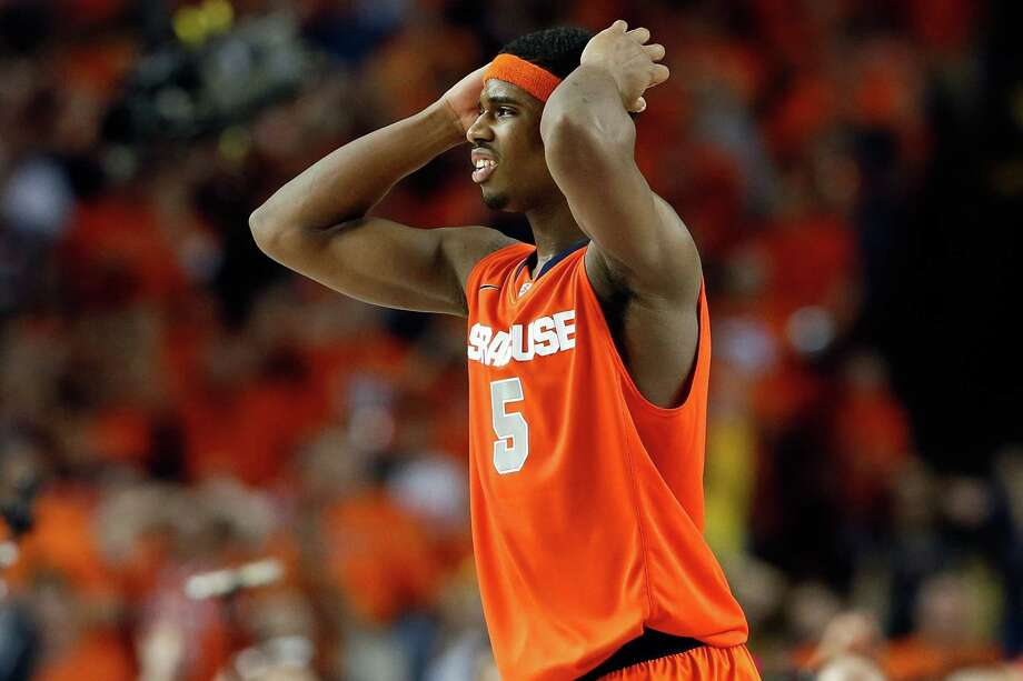 ATLANTA, GA - APRIL 06:  C.J. Fair #5 of the Syracuse Orange reacts in the second half against the Michigan Wolverines during the 2013 NCAA Men's Final Four Semifinal at the Georgia Dome on April 6, 2013 in Atlanta, Georgia. Photo: Kevin C. Cox, Getty Images / 2013 Getty Images