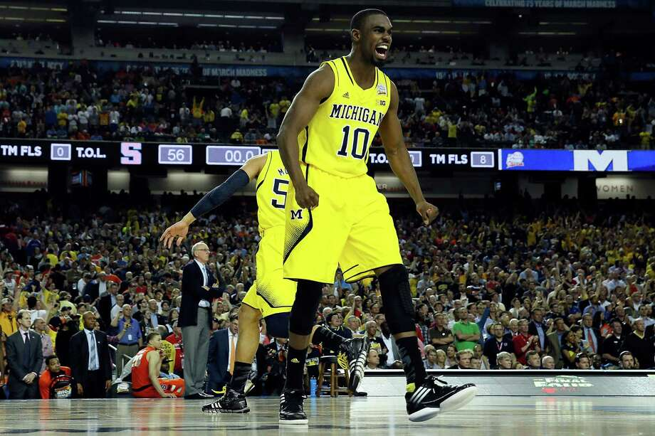 ATLANTA, GA - APRIL 06:  Tim Hardaway Jr. #10 of the Michigan Wolverines celebrates after they won 61-56 against the Syracuse Orange during the 2013 NCAA Men's Final Four Semifinal at the Georgia Dome on April 6, 2013 in Atlanta, Georgia. Photo: Streeter Lecka, Getty Images / 2013 Getty Images