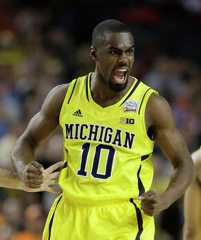 Michigan's Tim Hardaway Jr. (10) reacts to play against Syracuse during the second half of the NCAA Final Four tournament college basketball semifinal game Saturday, April 6, 2013, in Atlanta. (AP Photo/Charlie Neibergall) Photo: Charlie Neibergall, Associated Press / AP