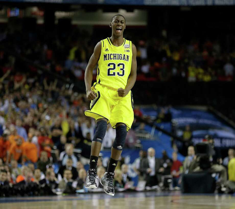Michigan's Caris LeVert (23) reacts during the second half of the NCAA Final Four tournament college basketball semifinal game against Syracuse, Saturday, April 6, 2013, in Atlanta. Michigan won 61-56. (AP Photo/Charlie Neibergall) Photo: Charlie Neibergall, Associated Press / AP