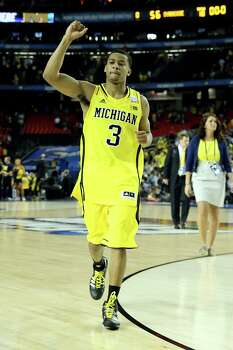 ATLANTA, GA - APRIL 06:  Trey Burke #3 of the Michigan Wolverines celebrates the Wolverines 61-56 victory against the Syracuse Orange during the 2013 NCAA Men's Final Four Semifinal at the Georgia Dome on April 6, 2013 in Atlanta, Georgia. Photo: Streeter Lecka, Getty Images / 2013 Getty Images