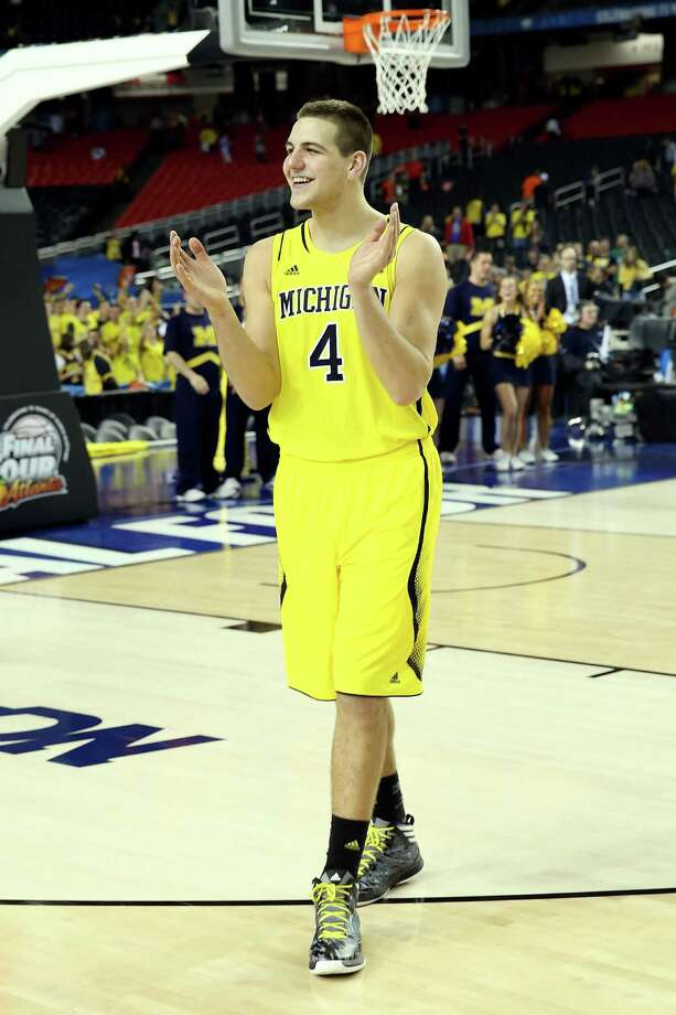 ATLANTA, GA - APRIL 06:  Mitch McGary #4 of the Michigan Wolverines celebrates the Wolverines 61-56 victory against the Syracuse Orange during the 2013 NCAA Men's Final Four Semifinal at the Georgia Dome on April 6, 2013 in Atlanta, Georgia. Photo: Streeter Lecka, Getty Images / 2013 Getty Images