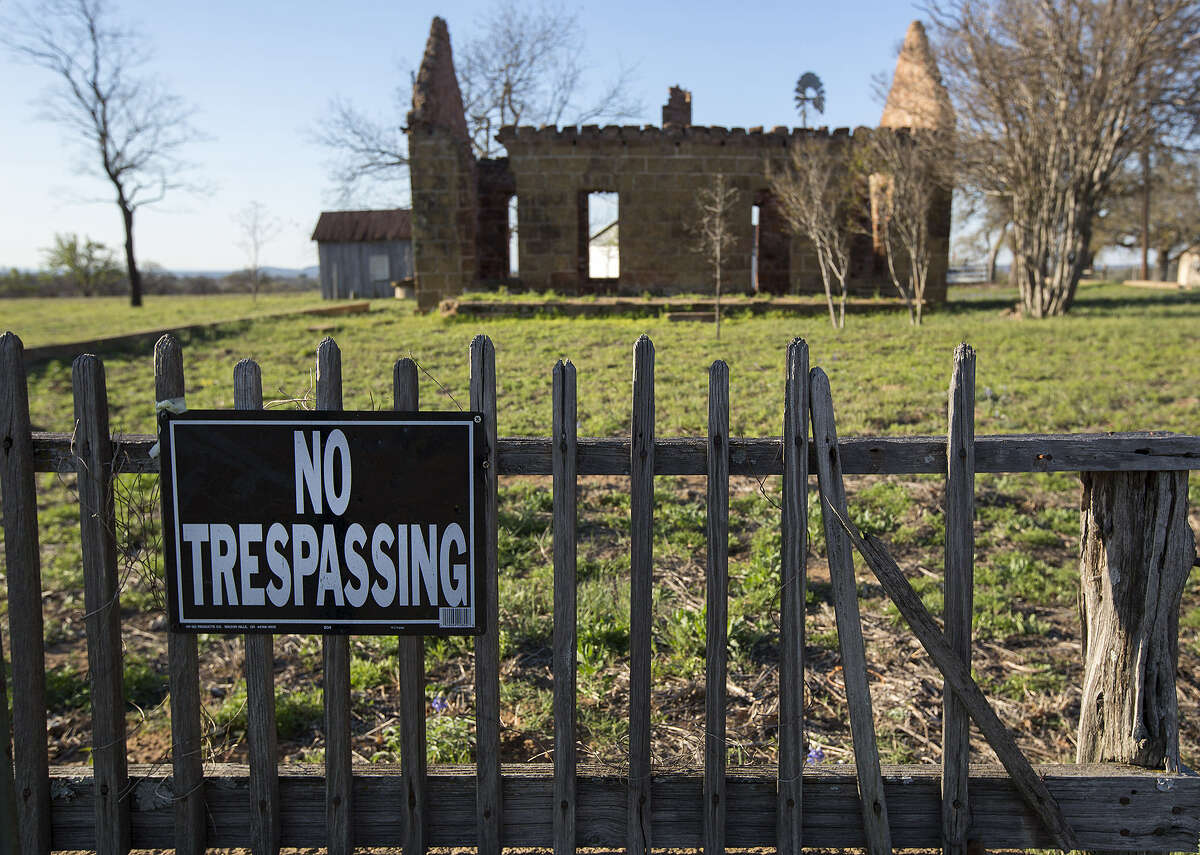 An abandoned building is guarded by a dilapidated fence in the tiny, nearly abandoned town of Pontotoc.