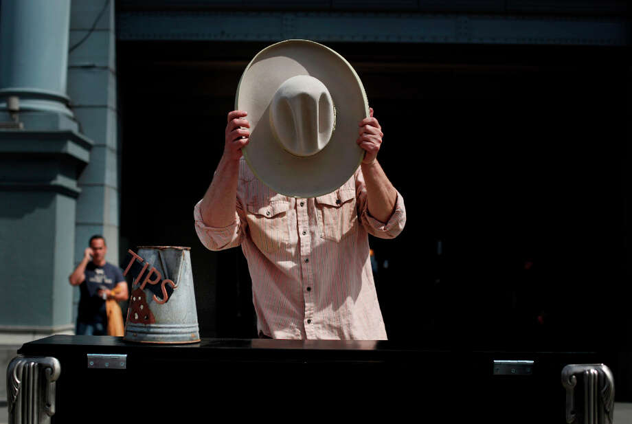 Gary Skaggs adjusts his Tom Mix Stetson hat while out for an afternoon of piano biking in San Francisco. Photo: Mike Kepka, The Chronicle / ONLINE_YES