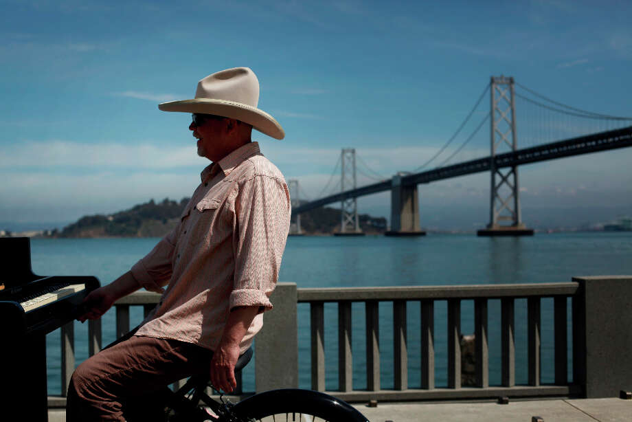 Gary Skaggs rides his piano bike down the Embarcadero in San Francisco. Photo: Mike Kepka, The Chronicle / ONLINE_YES