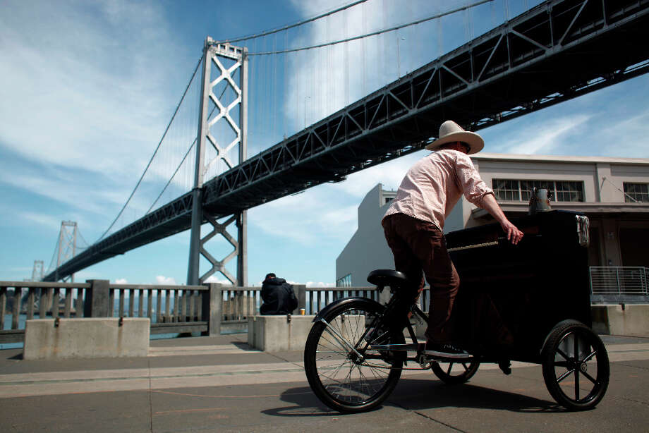 Gary Skaggs heads home after riding his piano bike in San Francisco. Photo: Mike Kepka, The Chronicle / ONLINE_YES