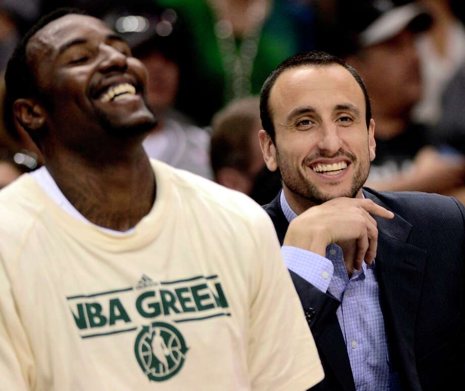 The Spurs\' Manu Ginobili (right)  laughs with teammate DeJuan Blair during the second half against the Atlanta Hawks, Saturday, April 6, 2013, at the AT&T Center. San Antonio won 99-97. Photo: Darren Abate, Associated Press / FR115 AP