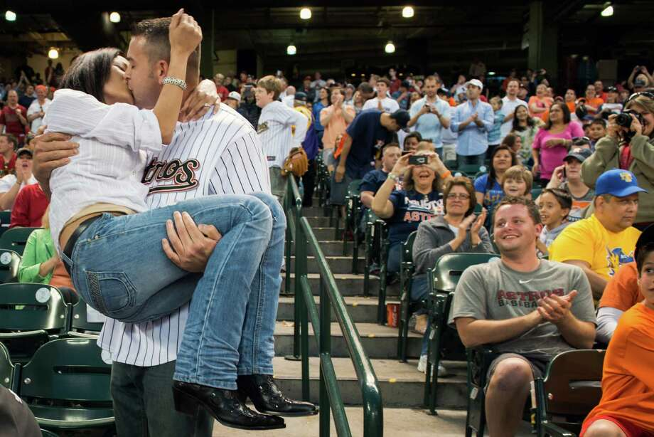 Richard Placette kisses his new fiancé Michelle Simpson after proposing marriage during the sixth inning. Photo: Smiley N. Pool, Houston Chronicle / © 2013  Smiley N. Pool
