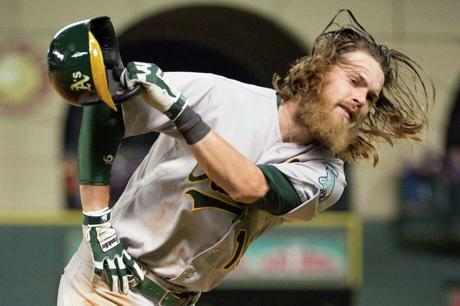 Oakland right fielder Josh Reddick reacts after bring called out at first to end the top half of the ninth inning. Photo: Smiley N. Pool, Houston Chronicle / © 2013  Smiley N. Pool