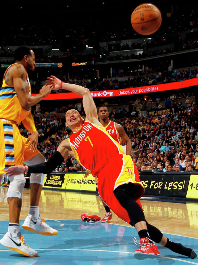 April 6: Nuggets 132, Rockets 114 Rockets point guard Jeremy Lin slides through the lane after losing his shoe and control of the ball as Andre Iguodala of the Nuggets defends. Photo: David Zalubowski