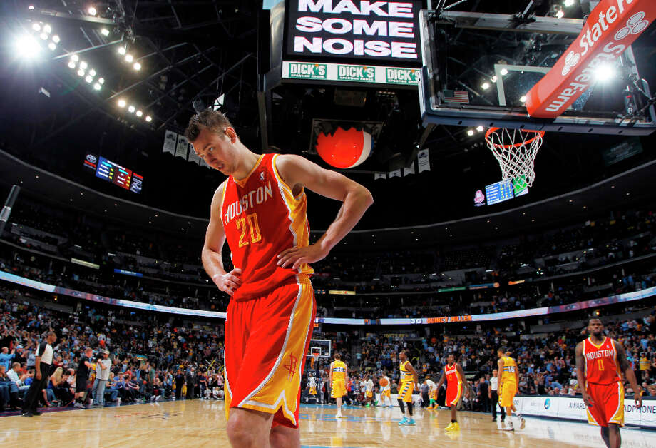 Rockets forward Donatas Motiejunas leaves the court dejected after Houston lost to the Nuggets. Photo: David Zalubowski