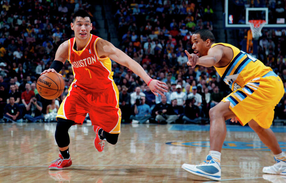 Andre Miller of the Nuggets defends Jeremy Lin of the Rockets. Photo: David Zalubowski