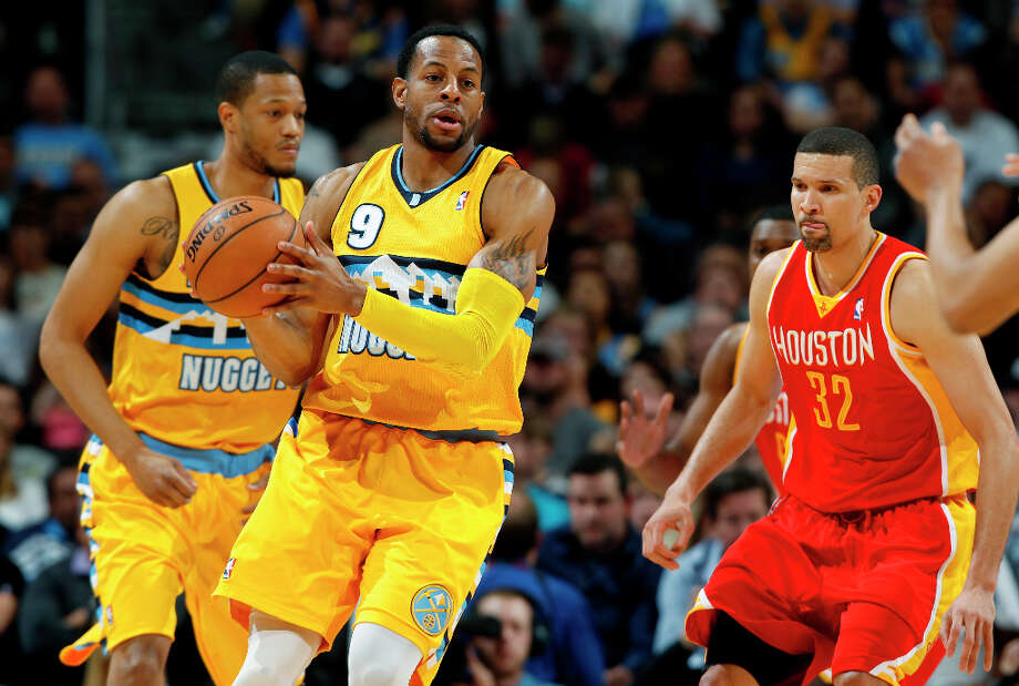 Andre Iguodala of the Nuggets moves the offense while Francisco Garcia of the Rockets defends. Photo: David Zalubowski