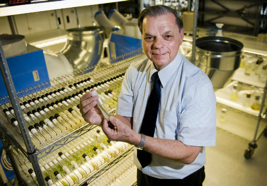 University of Texas professor Dr. Jerry Brand stands with vials of algae ready to be shipped all over the world from the University of Texas biology building. Photo: Ashley Landis, Houston Chronicle