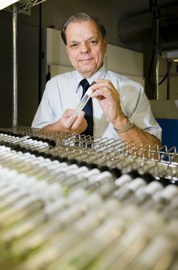 University of Texas Professor Jerry Brand with vials of algae ready to be shipped all over the world from the University of Texas biology building. Photo: Ashley Landis, Houston Chronicle