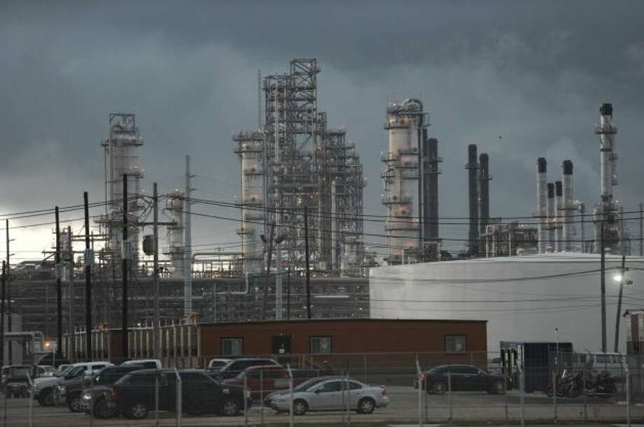 A storm rolls over the Motiva Enterprises refinery in Port Arthur. A recent expansion at the facility boosted capacity by 325,000 barrels a day. Photo: Associated Press