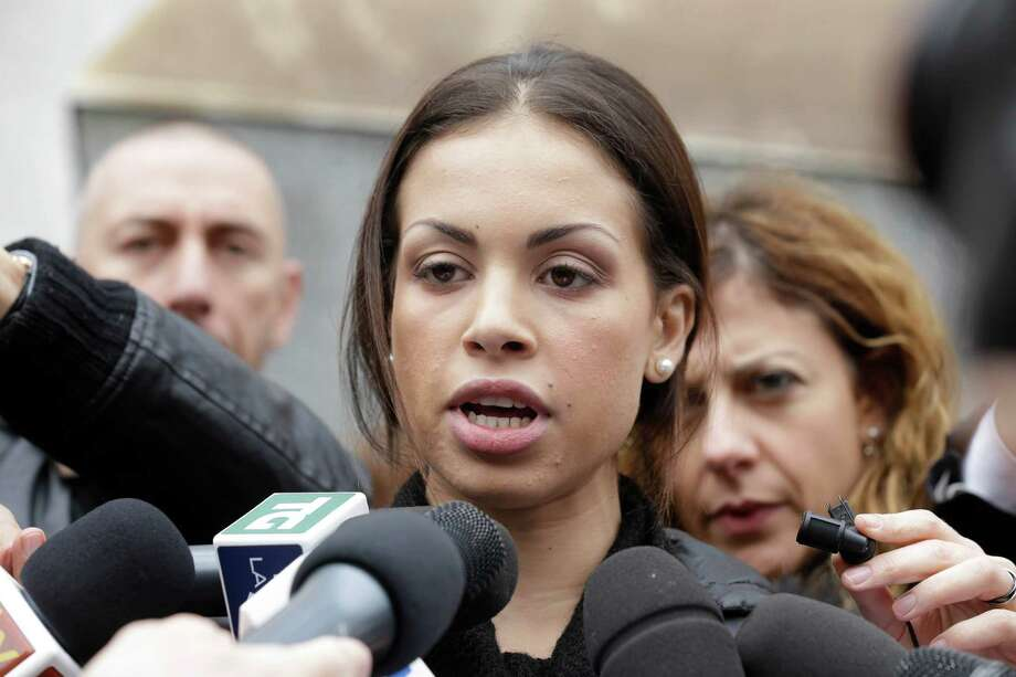 Karima el-Mahroug, the Moroccan woman at the center of ex-Premier Silvio Berlusconi's sex-for-hire trial, arrives at the court in Milan, Italy, Thursday, April 4, 2013.. Photo: AP