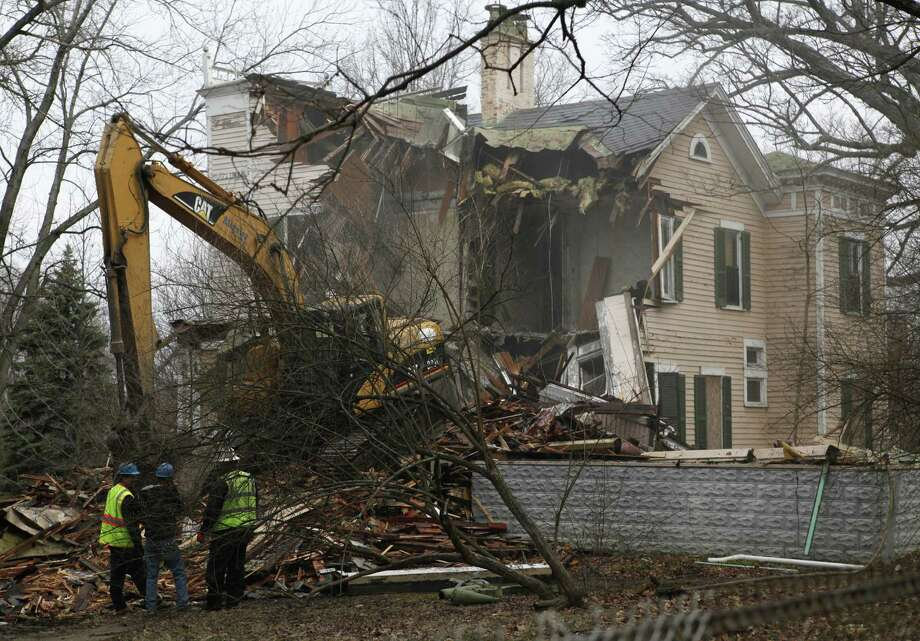 Demolition of the historic home of James N. Gamble is underway Monday morning April 1, 2013 in Westwood, Ohio. James N. Gamble was the inventor of ivory soap. Before the morning ended, the house was a pile of rubble.  The Enquirer/Carrie Cochran  (AP Photo/The Cincinnati Enquirer,Carrie Cochran ) Photo: AP