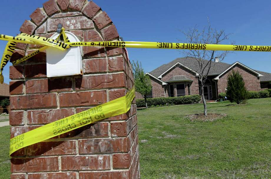 Crime scene tape is seen outside the home of Kaufman County District Attorney Mike McLelland Monday, April 1, 2013, near Forney, Texas. McLelland and his wife Cynthia were murdered at their home Saturday. Photo: AP