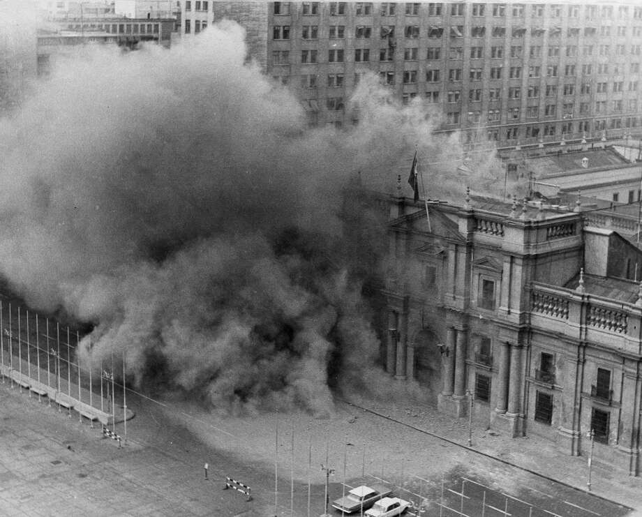 In this Sept. 11, 1973 file photo, La Moneda presidential palace in Santiago, Chile, is bombarded by military jets during a coup against President Allende's government.  The perseverance and persistence during the last two decades from the former driver and assistant of Chilean poet Pablo Neruda, who believes that the Pinochet dictatorship ordered the world-wide poet's assassination, prompted a human rights judge to order on Feb. 8, 2013 the exhumation of Neruda's body. But chances are that the exhumation won't be conclusive on whether the poet died in the middle of a treatment for prostate cancer or was killed by a doctor, whose existence no one can verify, to silence the vocal poet who was an active member of the Chilean Communist Party. Officially, Neruda died of cancer only days after the 1973 coup toppled his close friend, socialist President Salvador Allende. Photo: AP
