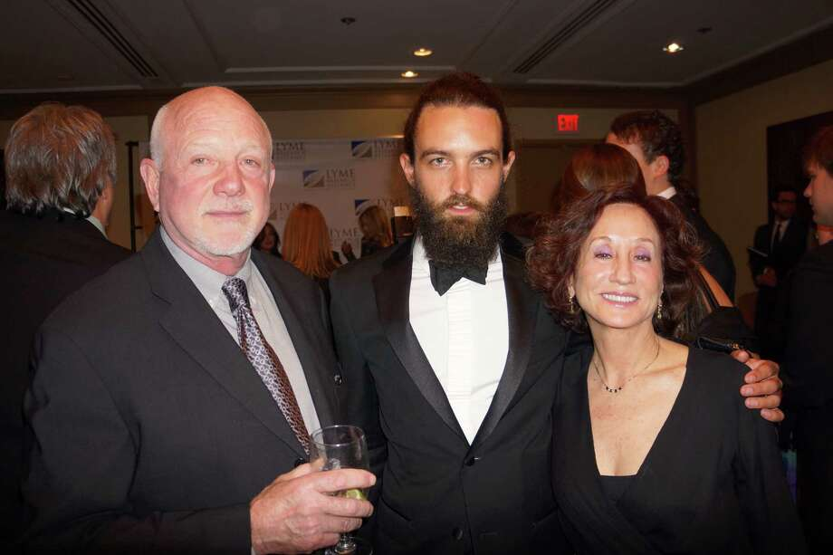 Steve Hash artist/designer (center) at the Time For Lyme Gala VIP Reception in Greenwich Saturday night? 4/6/2013 Photo: Todd Tracy/ Hearst Connecticut Media Group