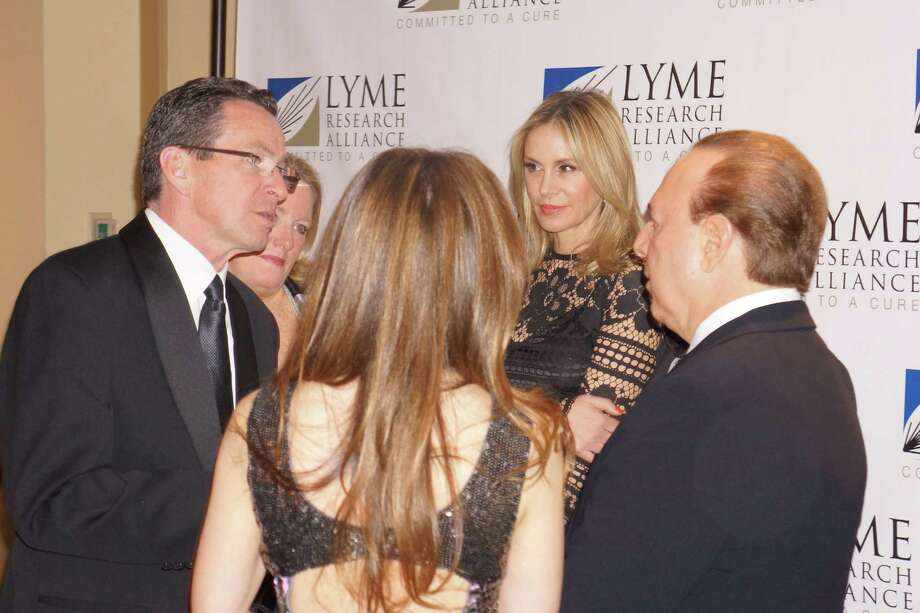 Ct Governor Dannel P. Malloy chats with Thalia & Tommy Mottola while Dee Ocleppo looks on at the Time For Lyme Gala VIP Reception in Greenwich Saturday night? 4/6/2013 Photo: Todd Tracy/ Hearst Connecticut Media Group