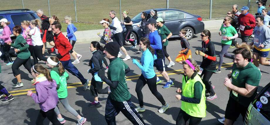 Runners start the 5K race at the StrattonFaxon Greater Danbury 5K race in Danbury, Conn. Sunday, April 7, 2013. Photo: Michael Duffy / The News-Times