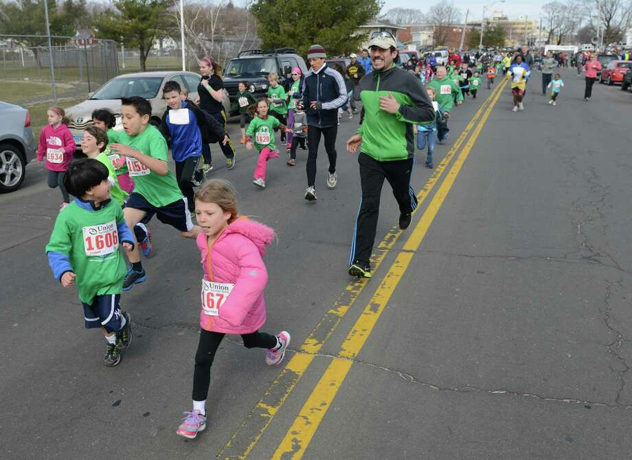 Children compete in the Union Savings Bank Kids Run at the Stratton Faxon Greater Danbury Half-Marathon and 5K road races at Rogers Park in Danbury, Conn. on Sunday, April 7, 2013.  Kataline Baehing, 11, of Hamden was the winner of the kids run. Photo: Tyler Sizemore / The News-Times