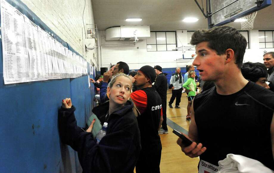 Runners check their numbers before the Stratton Faxon Greater Danbury Half Marathon and 5K race in Danbury, Conn. Sunday, April 7, 2013. Photo: Michael Duffy / The News-Times