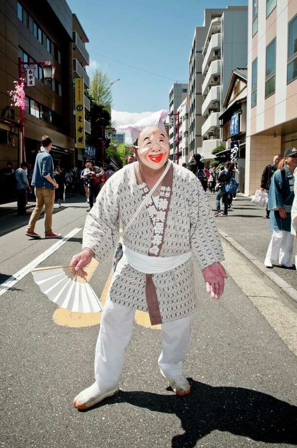 A Japanese man wears a face mask as he parades through the streets at Kanamara Matsuri (Festival of the Steel Phallus) on April 7, 2013 in Kawasaki, Japan. The festival is held annually on the first Sunday of April and it is centered around a local penis-venerating shrine once popular among prostitutes who wished to pray for protection from sexually transmitted diseases. The festival is now a popular tourist attraction. Photo: Keith Tsuji, Getty / 2013 Getty Images
