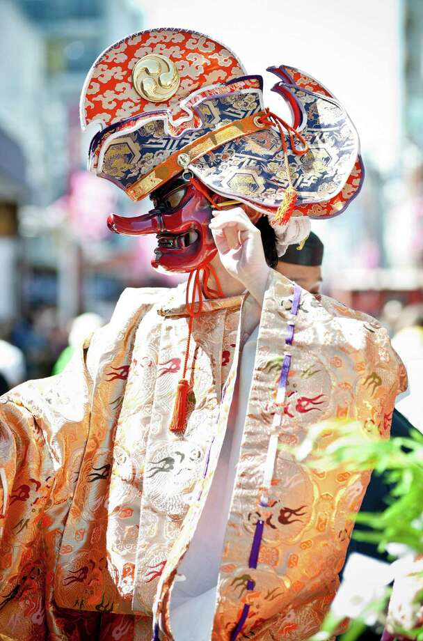 A Shinto Priest wears a 'Tangu' mask parades through the streets at Kanamara Matsuri (Festival of the Steel Phallus) on April 7, 2013 in Kawasaki, Japan. The festival is held annually on the first Sunday of April and it is centered around a local penis-venerating shrine once popular among prostitutes who wished to pray for protection from sexually transmitted diseases. The festival is now a popular tourist attraction. Photo: Keith Tsuji, Getty / 2013 Getty Images