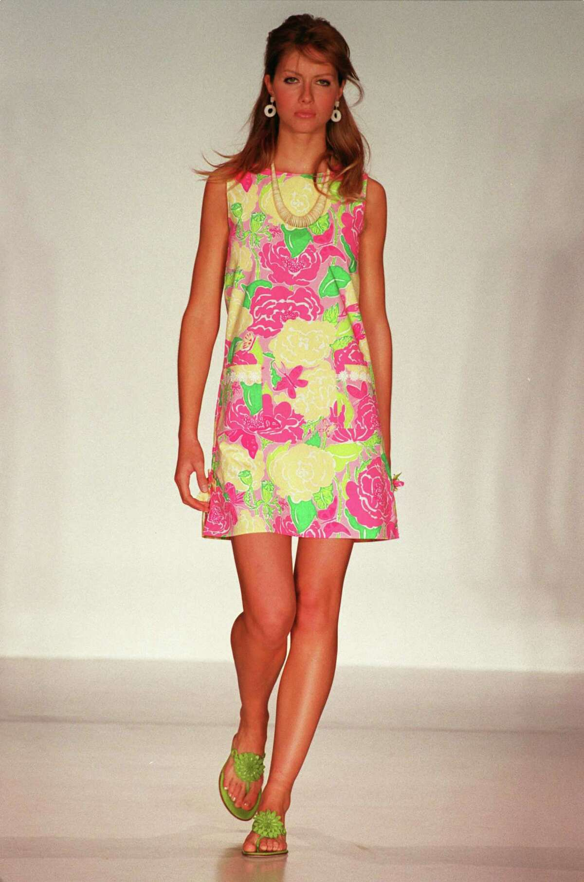 """09/2002 (5473) - New York - fashion by Lilly Pulitzer. HOUCHRON CAPTION (02/15/2003): OK, Lilly lovers, we know you're out there. We know about your penchant for brightly colored, beachy shift dresses. And we're not surprised by the preppy, coordinating ensembles you make your kids wear in family portraits. Now, there's a place for devotees of Lilly Pulitzer's """"Palm Beach chic."""" Houston's only Lilly Pulitzer Signature Store, Principessa, has opened in the River Oaks Shopping Center. Principessa, 1965 W. Gray, is packed with colorful dresses and the coordinating kiddy ensembles for which Pulitzer is known. The store also offers shoes, sandals, jewelry, handbags and swimwear. For information, access www.principessausa.com or call 713-807-0707. -- LIZ EMBRY."""